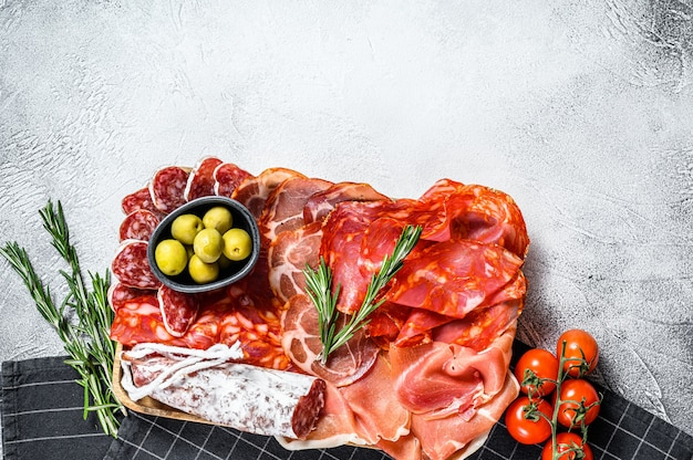 Cured meat platter of traditional spanish tapas. chorizo, jamon serrano, lomo and fuet. top view.