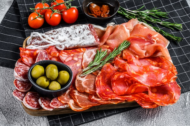 Cured meat platter of traditional spanish tapas.