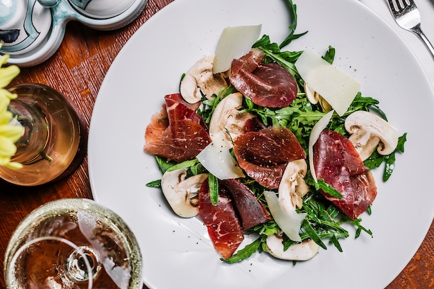 Cured meat with rocket mushroom and parmesan