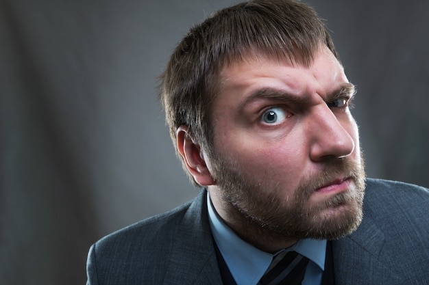 Curious businessman with wide open eye