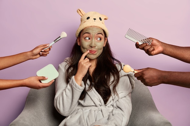 Curious cheerful lady rejoices new anti wrinkle mask, prevents signs of skin aging