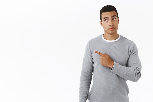 Curious handsome young hispanic man found something interesting