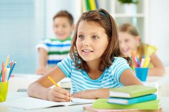 Curious schoolgirl in class