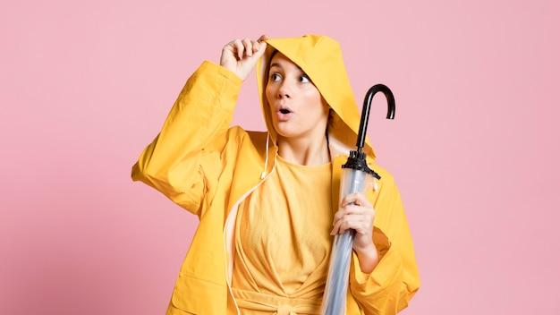 Curious woman holding an umbrella