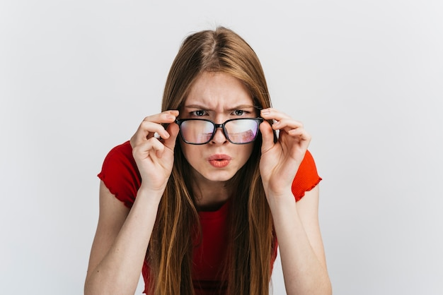 Curious woman with glasses staring