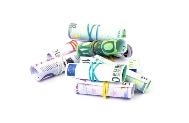 Curled euro bills on white isolated background