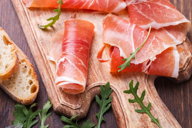 Curled slices of  prosciutto .snacks at parties.