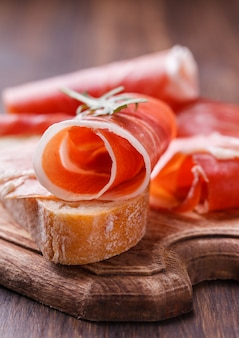 Curled slices of  prosciutto