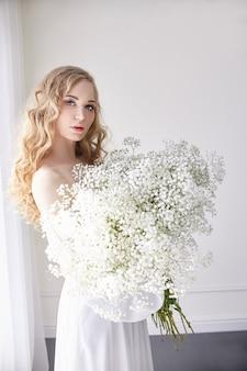 Curly blonde romantic look, beautiful eyes flowers