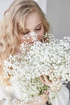 Curly blonde romantic look, beautiful eyes