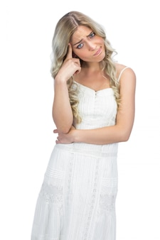 Curly haired blonde having interrogative posture