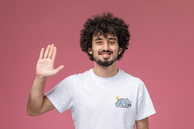 Curly haired guy giving high five