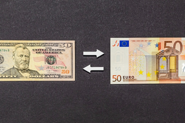 Currency conversion, the ratio of the dollar to the euro, currency exchange, two currencies on a black background. copy space