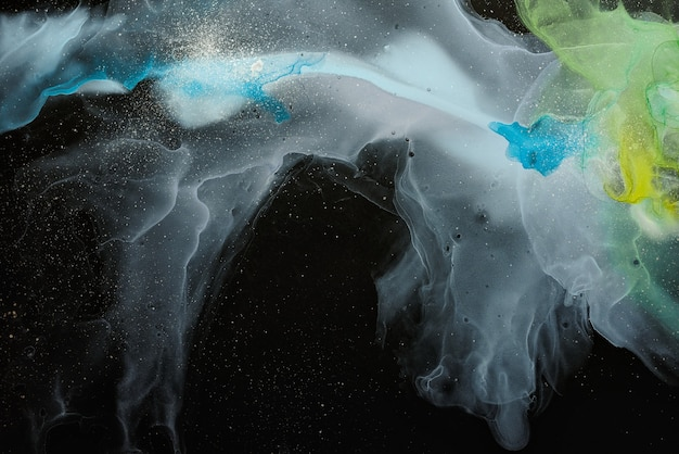 Currents of translucent hues snaking metallic swirls foamy sprays of color shape the space