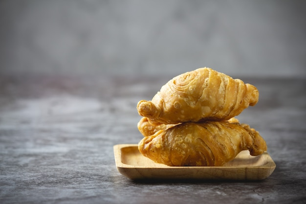 Curry puff pastry on concrete.