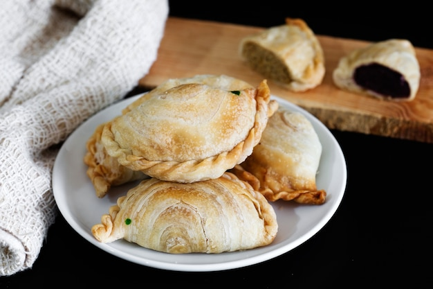 Curry puff on white plate.