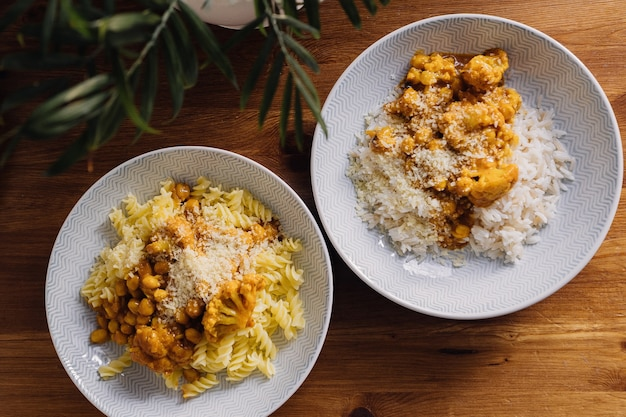 Curry with chickpeas and cauliflower served with rice and pasta