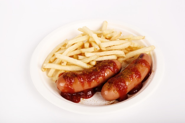 Curry wurst with sauce and french fries