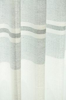 Шторы на окна, тюль с сетчатой фактурой в квартире