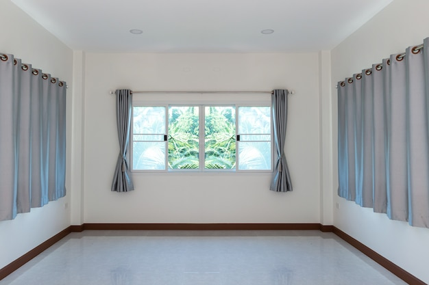 Curtains and window in a room