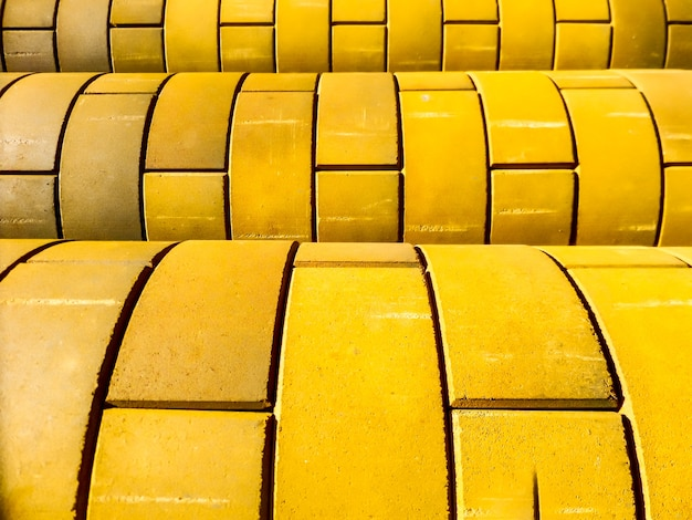 Curve of yellow color brick wall
