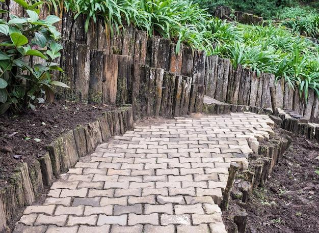 Curved brick pavement along the flower garden.
