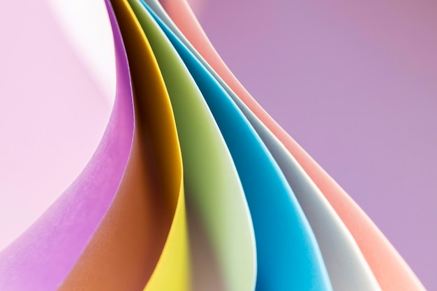 Curved layers of colored papers empty background