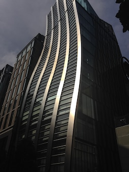 Curvy building bathed by direct sunlight in tokyo