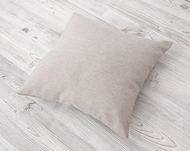 Cushions on the wooden surface