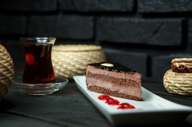 Custard chocolate sponge cake and cup of hot tea