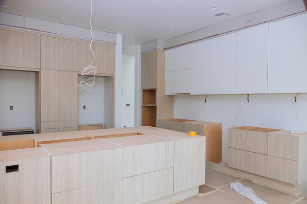 Custom kitchen cabinets in various stages of installation base