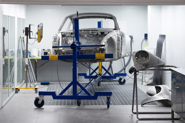 Custom sports car being build in workshop.