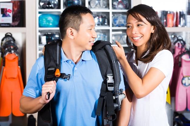 Customer buying equipment in divers shop