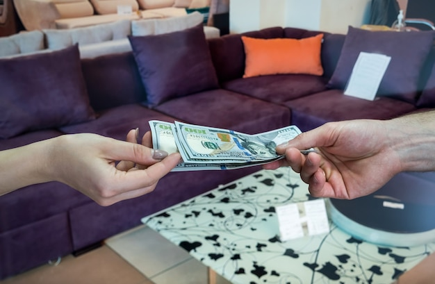 The customer buys new furniture in the store, gives dollars to the seller.