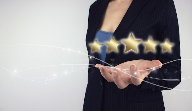 Customer experience concept. hand hold digital hologram five star symbol