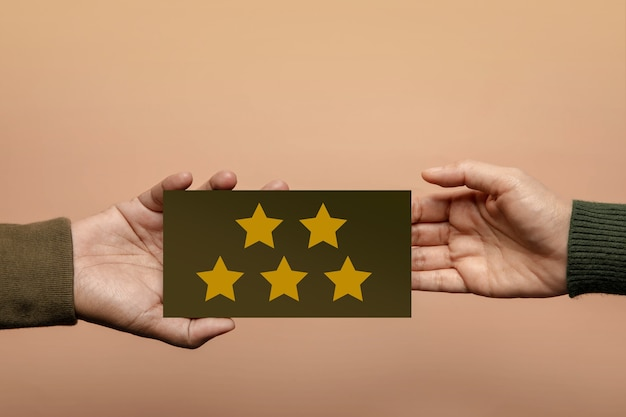 Customer experience concept. happy client giving five star rating feedback on card to a businessman. positive review. satisfaction survey