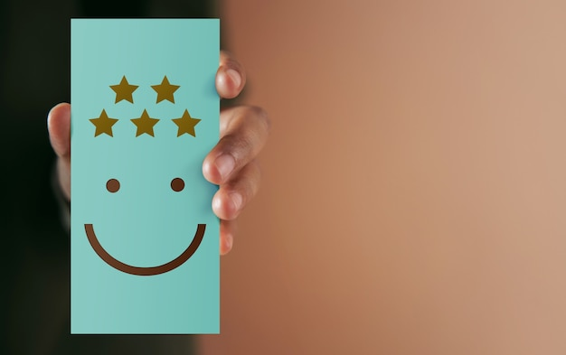 Customer experience concept. happy client giving positive review on paper card. client's satisfaction surveys