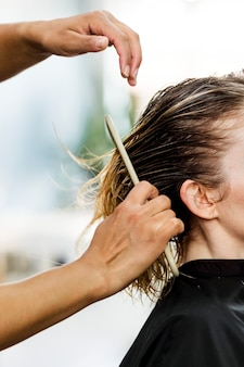 Customer getting a haircut in a beauty salon