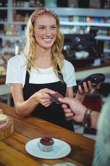 Customer giving credit card to waitress