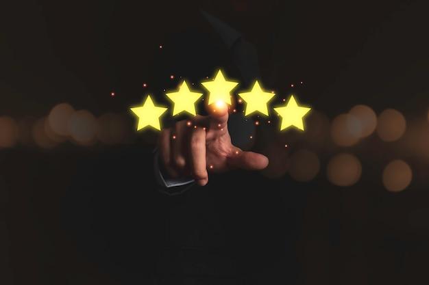 Customer hand touching to yellow illustration 5 stars virtual screening monitor