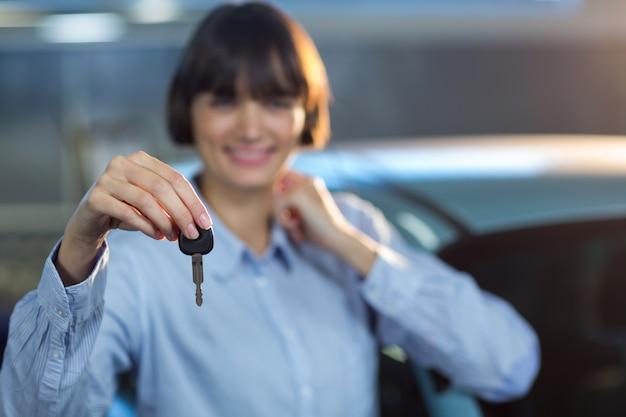 Customer holding a car key