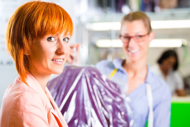 Customer in laundry shop or textile dry-cleaning