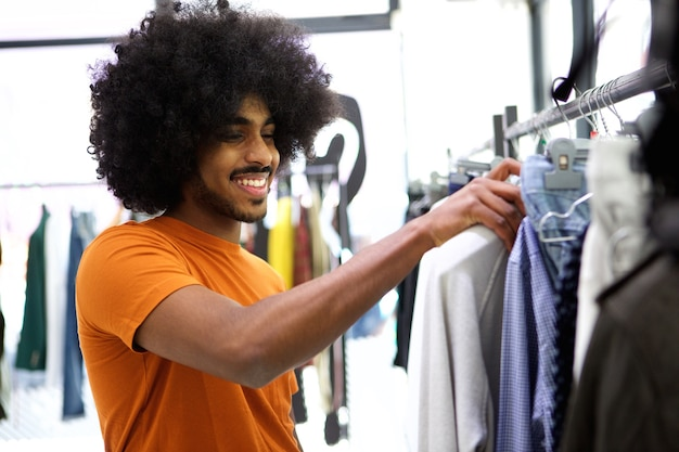 Customer looking for clothes to buy in store