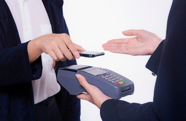 Customer making contactless payment using mobile phone