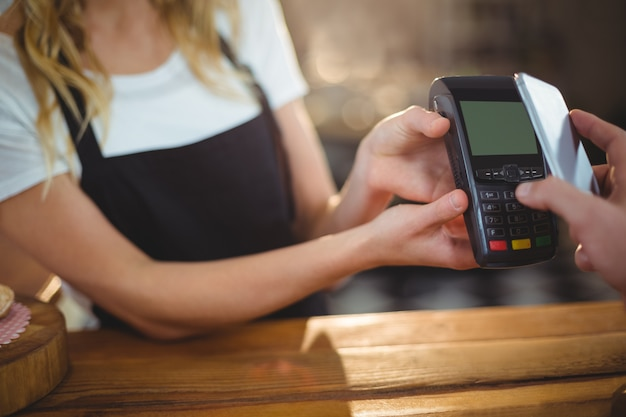 Customer paying bill through smartphone using nfc technology