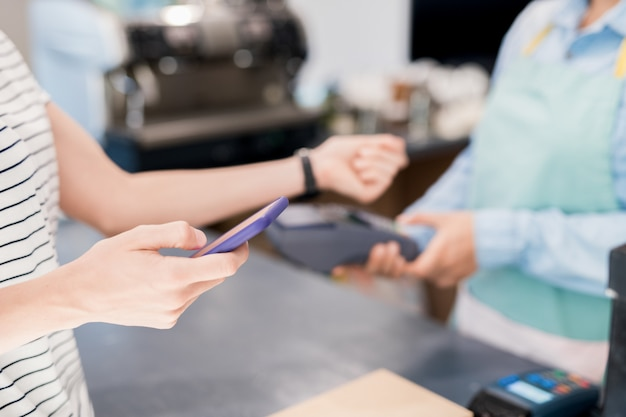 Customer paying by nfc