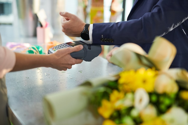 Customer paying in shop