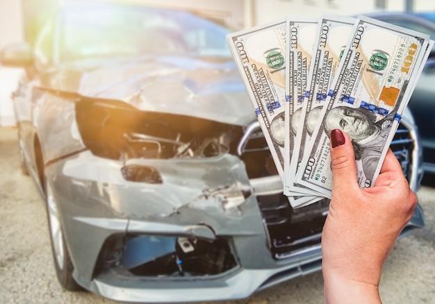 Customer pays money dollars for car repair. Premium Photo