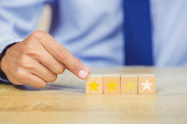 Customer pressing star on wood cube