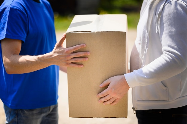 Customer receiving box from delivery man